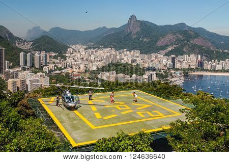 Rio de Janeiro, Brazil - December 21, 2012: Tourists enjoying the Helicopter aerial tour from Sugarloaf Mountain in Rio de Janeiro, Brazil.