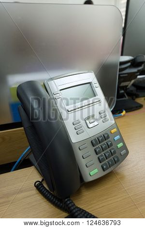 black telephone on table work of office