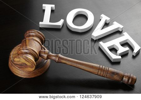 Judges Gavel And Sign Love On The Black Wood Background