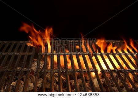 Barbecue Charcoal Grill Close-up With Bright Flames In The Black Background