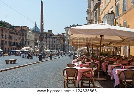 ROME-AUGUST 8: Restaurant on the Piazza Navona on August 8 2013 in Rome. Piazza Navona is a city square in Rome Italy.