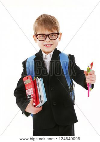 Schoolboy with backpack holding books and pens isolated on white