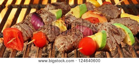 Barbecue Beef Kebabs On The Hot Grill Close-up.