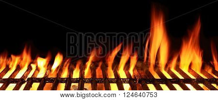 Empty BBQ Grill With Bright Flames On The Black Background