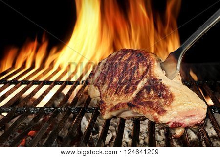 Pork Loin Steak On Hot Flaming Barbecue Grill With Fork