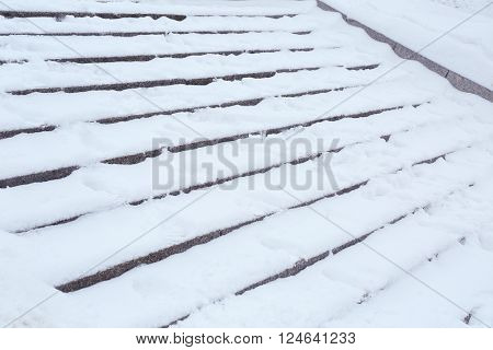 Snow-covered stairs, closeup