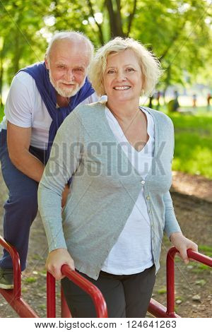 Two active senior people on a keep fit trail in summer