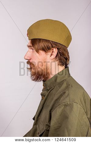 Portrait Of A Russian Soldier, A Profile Headshot Against