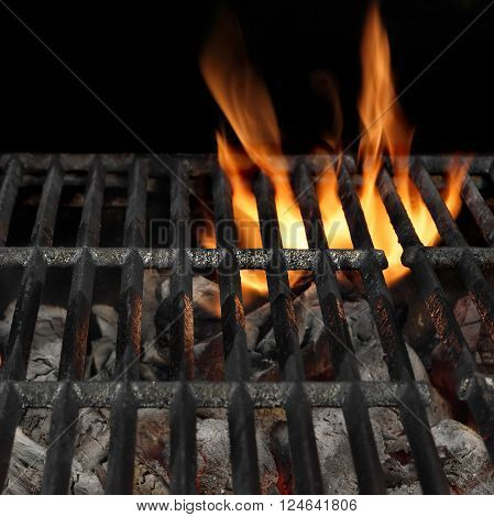 Empty Barbecue Flaming Charcoal Grill With Bright Flames Of Fire Isolated On The Black Square Background Close-up Copy Space Top View.