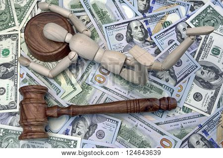 Wooden Human Figurine On The Sound Block And Cash Background