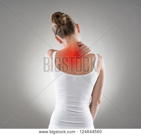 Neck cramp. Young woman having back illness.