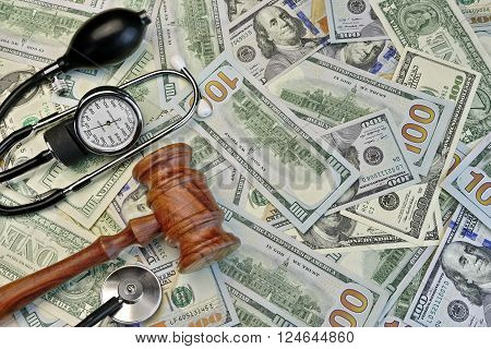 Judges Gavel And Medical Tools On Dollar Cash Background