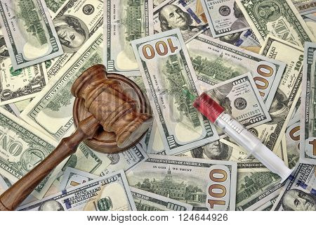 Judges Gavel And Syringe With Injection On Dollar Cash Background