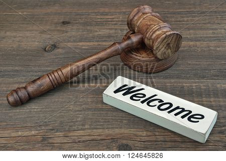 Judge Or Auctioneer Gavel And Sign Welcome On Wood Background