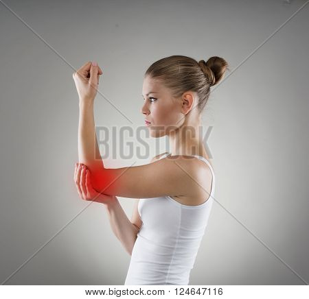 Young girl having hurt elbow. Bone dislocation concept.