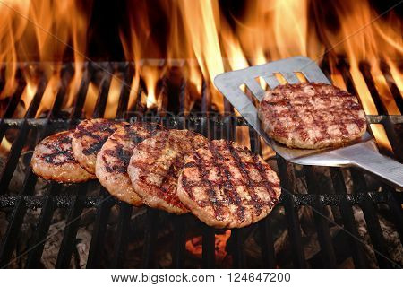 Beef Burgers On The Hot Flaming Bbq Charcoal Grill