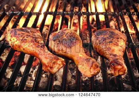 BBQ Chicken Legs Roasted On The Hot Flaming Charcoal Grill, Top View Close Up