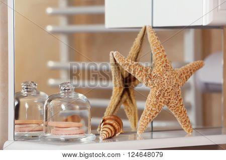 Sponges and starfish on a shelf in bathroom