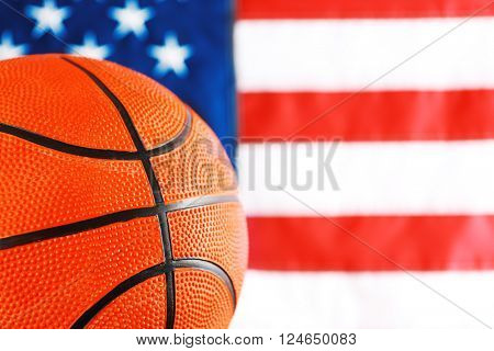 Basketball on background of American flag. Popular sport concept