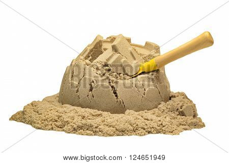 Damaged Sand Castle Tower And A Shovel Isolated On White