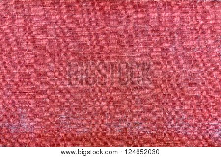 rough texture of old material from cotton or from a sackcloth for a textile background or for wallpaper of red color with attritions