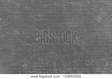 texture of rough old material from cotton or from a sackcloth for a textile background or for wallpaper of gray color with attritions
