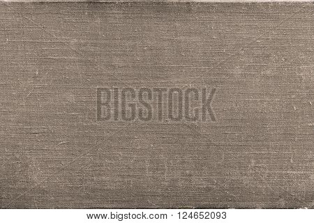rough texture of old material from cotton or from a sackcloth for a textile background or for wallpaper of beige color with attritions