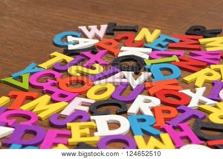 English Wooden Colorful Letters On The Brown Wood Background
