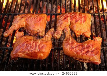 Four Chicken Leg Quarter Roasted On Hot Bbq Flaming Grill