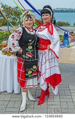 Dnepropetrovsk Ukraine - September 14 2013: Ukrainian women in national costumes show home cooking and folk art