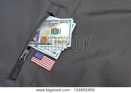 Money Pile Stuck Out Of Military Khaki Coat Pocket