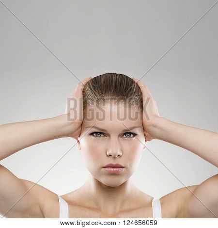 Portrait of woman touching her painful temples with copy space. Neurology. Brain disease. Insomnia concept.