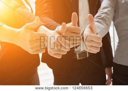 Group of business people showing thumb up gesture