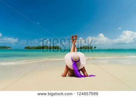 Woman at the beach in at the tropical resort