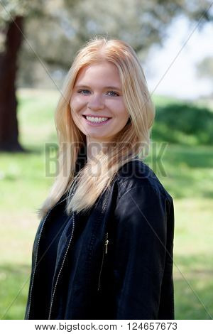 Cool blonde girl enjoying of good time at spring