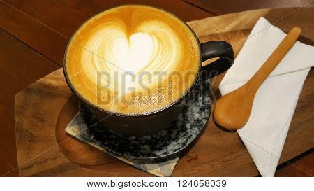hot milk coffee latte with latte art