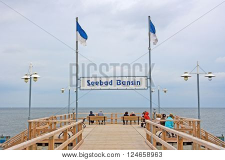 Bansin Usedom Germany - June 27 2012: Pier of the baltic sea spa town Bansin - a famous tourist hotspot. Pier sign labeled with sea spa town Bansin (Seebad Bansin).