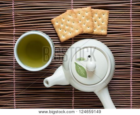 Top view of green tea matcha  with cracker