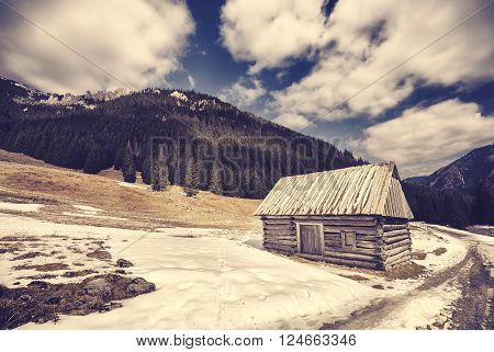 Vintage Stylized Wooden Hut By A Road In Tatra Mountains.