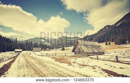 Vintage Toned Wooden Hut By A Road In Tatra Mountains.