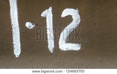 Number Twelve  On The Metall Plate