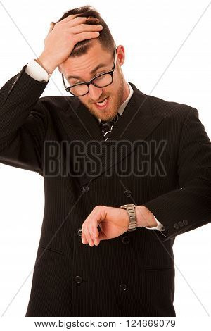 Successful businessman in formal suit chacking time on wrist watch isolated over white.