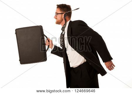 Successful businessman in formal suit and briefcase, running being late isolated over white.