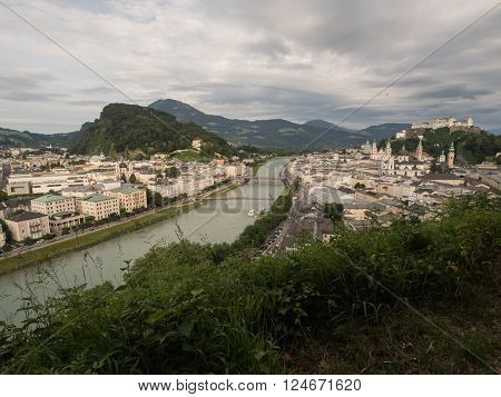 A view of the houses standing round the floating river Salzach in Salzburg 2015