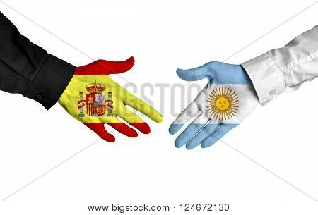 Spain and Argentina leaders shaking hands on a deal agreement