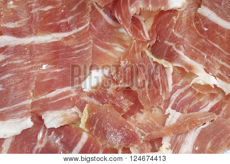 Iberian ham strips cut on a plate