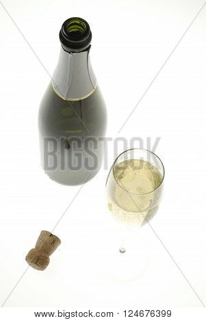 Bottle of champagne and glass fullI on white background