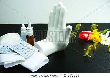 Stop allergy concept seasonal pollen and blossom allergy medication and tissues copy space