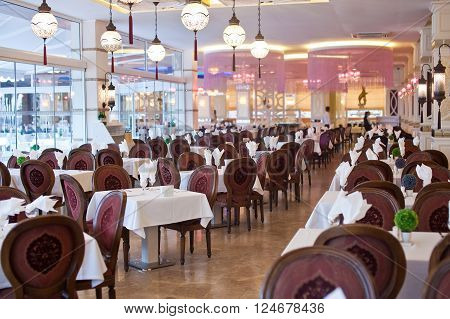 Empty hall of the restaurant with vinous chairs