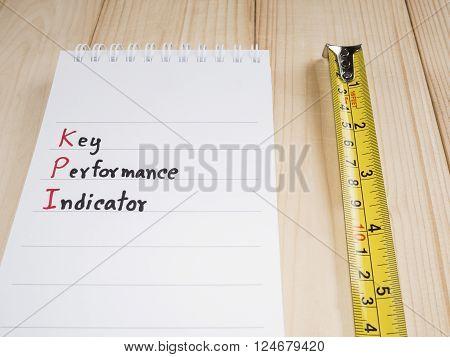 KPI (Key Performance Indicator) with wood background (Business concept)
